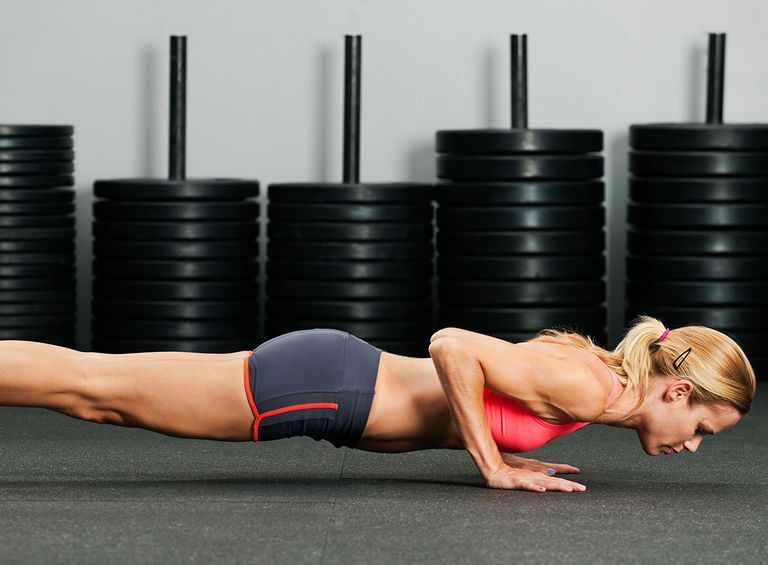Extended Wide Grip Pulsing Push-Ups
